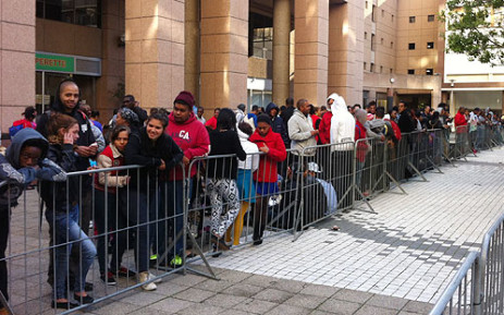 FILE: People queue outside South Africa's first Burger King outlet, ahead of its opening in Cape Town on 9 May 2013. Picture: Rafiq Wagiet/EWN