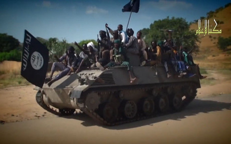 FILE: A screengrab taken on 9 November , 2014, from a new Boko Haram video released by the Nigerian Islamist extremist group Boko Haram and obtained by AFP shows Boko Haram fighters parading on a tank in an unidentified town. Picture: AFP.