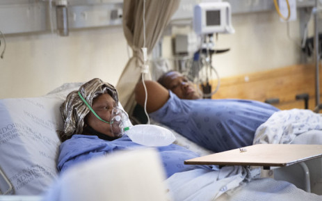 FILE: Two patients with COVID-19, one (L) breathing in oxygen, in the COVID-19 ward at Khayelitsha Hospital, about 35km from the centre of Cape Town, on 29 December 2020. Picture: RODGER BOSCH/AFP