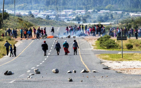 Protesters in Grabouw in the Western Cape block the road during a demonstration over the lack of housing, poor and expensive electricity supply and bad road conditions on Tuesday, 16 September 2014. Picture: Sapa.