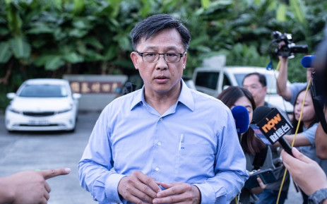 FILE: This picture taken on 23 July 2019 shows Hong Kong pro-Beijing government lawmaker Junius Ho leaving the cemetery after learning his parents' gravestones were vandalised in the Tuen Mun district of Hong Kong. Picture: AFP