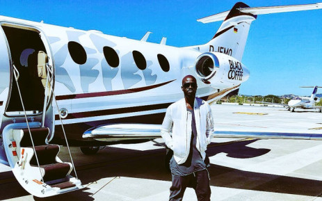 Black Coffee poses next to a personalised jet. Picture: @RealBlackCoffee/Twitter