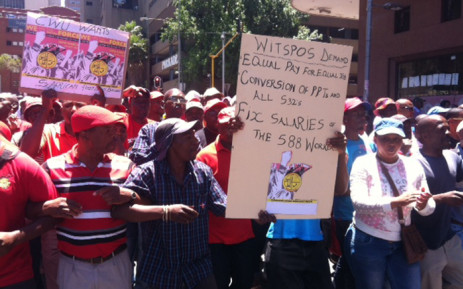 About 1,000 Communication Workers Union members sing and dance in the streets of Johannesburg as they march for a bailout from government. Picture: Kgothatso Mogale/EWN.
