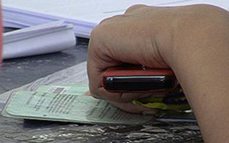 FILE: A resident checks her name at a voting station. Picture: EWN