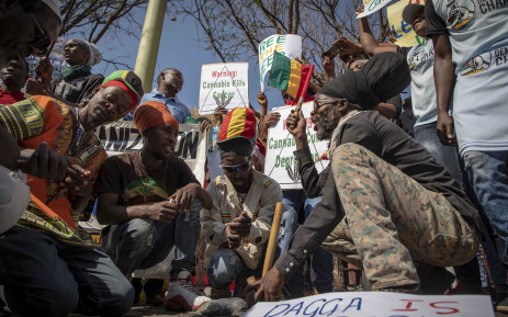 Rastafarians smoke cannabis outside the South African Constitutional Court on 18 September 2018 before the ruling on the private use marijuana is delivered. Picture: Thomas Holder/EWN