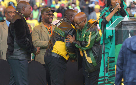 ANC deputy president Cyril Ramaphosa greets party leader Jacob Zuma during the party's 105th birthday celebration event at the Orlando Stadium in Soweto. Picture: Christa Eybers/EWN