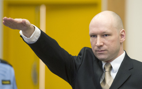 Norwegian mass killer Anders Behring Breivik makes a Nazi salute as he arrives to a makeshift court in Skien prisons gym on 15 March, 2016 in Skien, some 130 km south west of Oslo, for his lawsuit against the Norwegian state, which he accuses of violating his human rights by holding him in isolation. Picture: AFP.