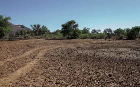 A general view of a dried-up farm dam is seen on 25 November 2019 at a cattle farm on the outskirts of Windhoek, Namibia. Namibia adopted a 'willing-buyer willing-seller' approach to land reform at independence in 1990. Picture: AFP.