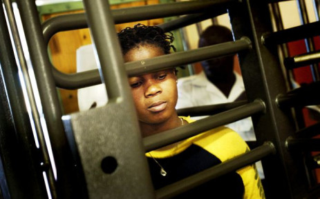 FILE: A Zimbabwean illegal immigrant goes through a gate on 8 March 2004 at the Lindela Repatriation Centre. Picture: AFP.