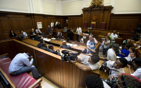 FILE: Zola Tongo covers his head as he prepares to face murder charges in the Cape High Court. Picture: AFP.