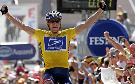 A file picture taken on July 22, 2004 shows Yellow jersey US Lance Armstrong (US Postal/USA) celebrating as he crosses the finish line and wins the 17th stage of the 91st Tour de France cycling race between Bourg-d'Oisans and Le Grand Bornand. Picture: AFP