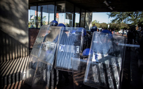 Private security agents working for the University of Johannesburg take position as they shut the gates of the campus during clashes with rioting students, on September 28, 2016. Pciture: AFP