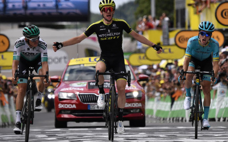 Great Britain's Simon Yates (C), flanked by Austria's Gregor Muhlberger (L) and Spain's Peio Bilbao, celebrates as he wins on the finish line of the twelfth stage of the 106th edition of the Tour de France cycling race between Toulouse and Bagneres-de-Bigorre, in Bagneres-de-Bigorre on 18 July 2019. Picture: AFP