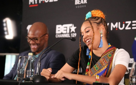 Sho Madjozi addresses media at a press conference at OR Tambo International Airport. Picture: @NathiMthethwa/Twitter.