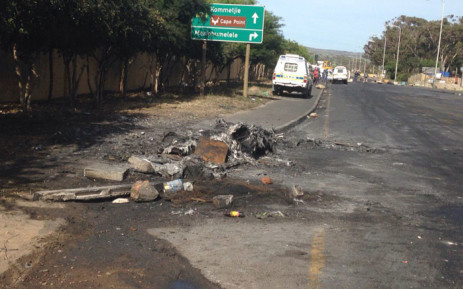 FILE: The crowds have dispersed for the most part in Masiphumelele. Rubber bullets heard from time to time after protest action erupted on Friday 23 October 2015. Picture: Lauren Isaacs/EWN.