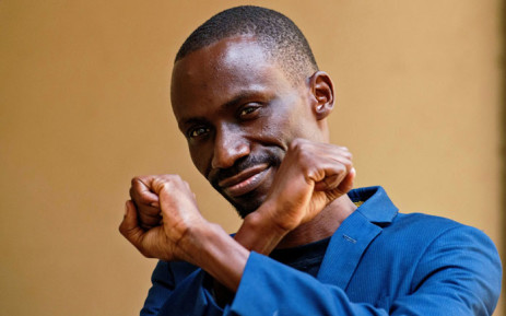 FILE: In this file photo taken on 19 December 2016 digital activist Maxence Melo gestures prior to appearing in court for his bail hearing in Dar es Salaam. Picture: AFP
