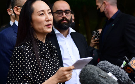 Huawei chief financial officer Meng Wanzhou (C) talks to media at British Columbia Supreme Court after her extradition hearing ended in her favour, in Vancouver British Columbia, Canada on September 24, 2021. Picture: AFP.