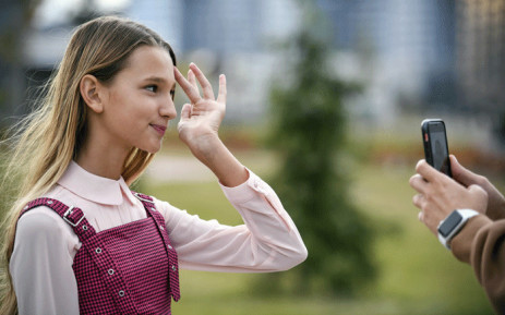 Russian child blogger Liza Anokhina, 12, participates in a shoot for her blog in a Moscow park on September 13, 2019. Liza Anokhina is one of Russia's most popular child bloggers with 2.3 million followers on Instagram. Picture: AFP.