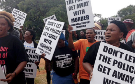 Protesters outside the Marikana Commission of Inquiry which has since seen a number of parties withdraw from proceedings. Picture: Gia Nicolaides/EWN