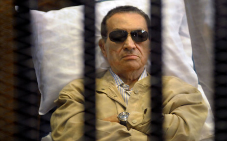 Egypt's two former presidents appear in a Cairo court