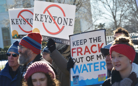 FILE: Demonstators take part in a protest outside of the White House against the building of the proposed Keystone XL oil pipeline on 10 January 2015 in Washington, DC. Picture: AFP