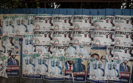A picture taken on 11 February 2019 shows a wall covered with posters of presidential candidate Atiku Abubakar of the Peoples Democratic Party (PDP,) the official opposition party, in Lagos. Picture: AFP