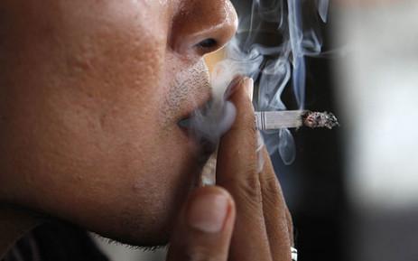 A man smokes a cigarette. Picture: AFP