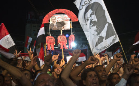 EGYPT, Cairo : Members of the Muslim Brotherhood and supporters of Egypt's ousted president Mohammed Morsi take part in a sit-in protest outside the Rabaa al-Adawiya mosque in Cairo on August 12, 2013. Picture: AFP