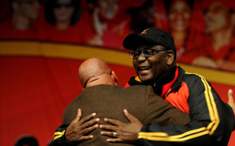 Cosatu general secretary Zwelinzima Vavi laughs while hugging President Jacob Zuma at the trade union federation's 11th national congress at Gallagher Estate in Midrand on Monday, 17 September 2012. Picture: Werner Beukes/SAPA