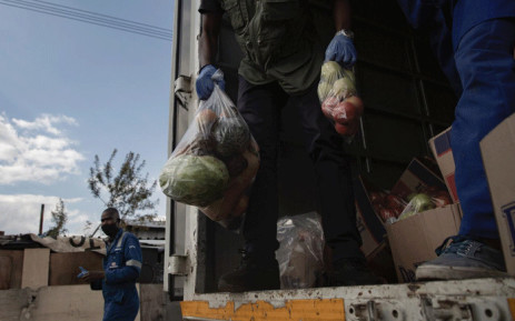Food parcels distributed to resident of Booysens informal settlement on 29 April 2020. Pictures: Sethembiso Zulu/EWN.