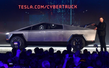 Tesla co-founder and CEO Elon Musk gestures while wrapping up his presentation of the newly unveiled all-electric battery-powered Tesla Cybertruck at Tesla Design Center in Hawthorne, California on 21 November 2019. Picture: AFP