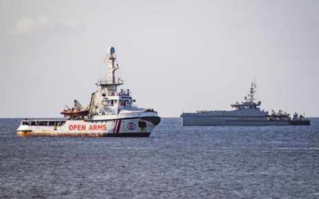 The Italian Guardia di Finanza boat sails towards the Spanish migrant rescue NGO ship Open Arms to retrieve 27 unaccompanied minors and take them to the Italian island of Lampedusa on 17 August 2019. Picture: AFP