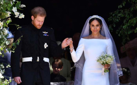 Britain's Prince Harry, Duke of Sussex and his wife Meghan, Duchess of Sussex emerge from the West Door of St George's Chapel, Windsor Castle, in Windsor, on 19 May 2018 after their wedding ceremony. Picture: AFP.
