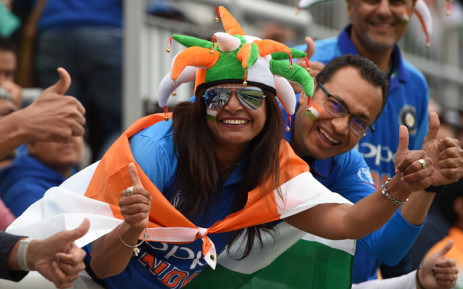 FILE: Indian supporters pose for a photograph in the crowd during the 2019 Cricket World Cup first semi-final between India and New Zealand at Old Trafford in Manchester, north-west England, on 9 July 2019. Picture: AFP