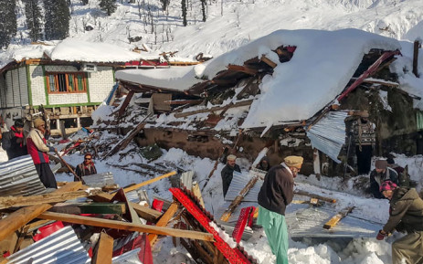 Local residents remove debris of a collapsed house following heavy snowfall that triggered an avalanche in Neelum Valley, in Pakistan-administered Kashmir on 14 January 2020. Picture: AFP