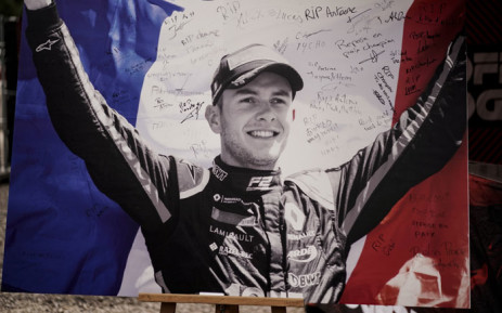 This picture taken on 1 September 2019 shows the portrait of BWT Arden's French driver Anthoine Hubert covered with condolence messages at the entrance of the Spa-Francorchamps circuit in Spa, Belgium. Picture: AFP