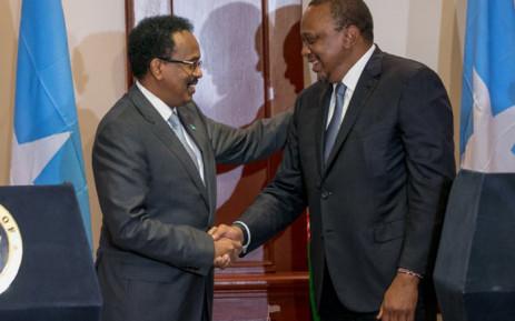 Kenyan President Uhuru Kenyatta shakes hands with Somalian President Mohamed Farmaajo. Picture: State House Kenya/Twitter