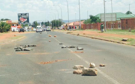 Protestors in Randfontein have blockaded roads with rocks and garbage. Picture: Masego Rahlaga/EWN.
