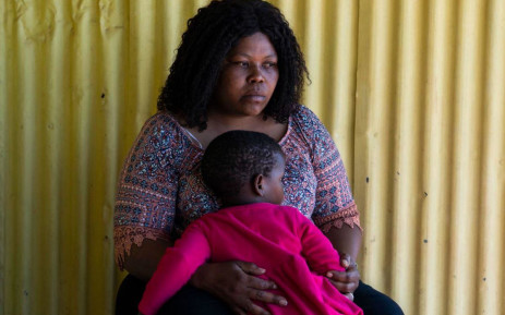 1 September 2021: Vuyokazi Yvone Mathebula, whose younger sister Nonhle Gloria Aphane was murdered in June, comforts one of Aphane's three children. Picture: New Frame.