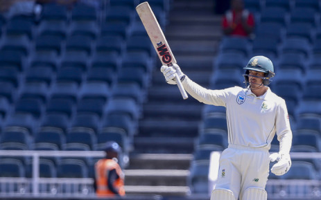 South Africa's batsman Quinton de Kock raises his bat as he celebrates a half-century (50 runs) during the third day of the third Cricket Test match between South Africa and Pakistan at Wanderers cricket stadium on 13 January 2019 in Johannesburg, South Africa. Picture: AFP