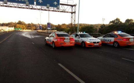 Clean up operations on the M1 following a paint spillage. Picture: Supplied.