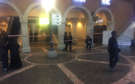 Red tape has been put around the area where a man doused himself with petrol and set himself alight at the Montecasino in Johannesburg on Sunday 24 July 2016. Picture: Thando Kubheka/EWN.