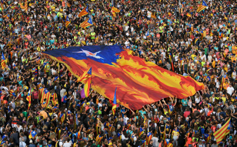 """People hold Catalan pro-independence """"estelada"""" flags during a demonstration in Barcelona, on 18 October 2019, on the day that separatists have called a general strike and a mass rally. Picture: AFP"""