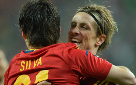 Spanish midfielder David Silva (L) is congratulated by Spanish forward Fernando Torres (R) after scoring a goal during the Euro 2012 championships football match Spain vs Republic of Ireland on June 14, 2012. Picture: AFP.