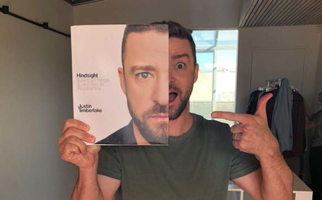 Justin Timberlake posing with his book, 'Hindsight', which is set to be released in October. Picture: @jtimberlake/Twitter.