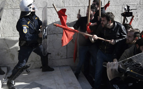 Demonstrators clash with police as they try to take the stairs leading to the parliament building in Athens on 12 January 2018, as part of a strike wave against changes to a 36-year-old industrial action law demanded by the country's creditors. Picture: AFP.