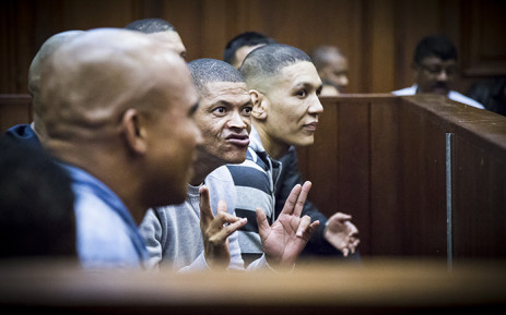 Alleged leader of the 28s gang, George Thomas, and his 17 co-accused in court on 4 May 2015. Picture: Thomas Holder/EWN.