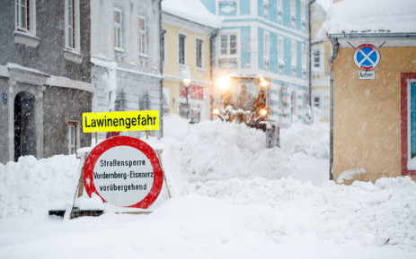 """A street sign reading """"danger of avalanches"""" stands on a snow covered street on 10 January 2019 in Vordernberg, Austria. Picture: AFP"""