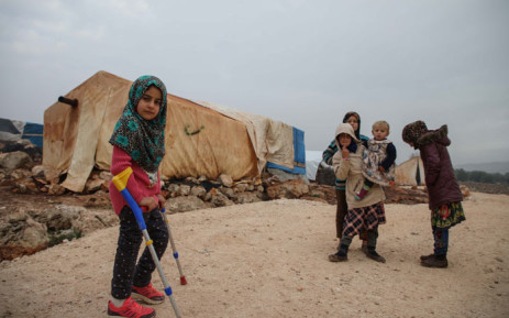 Syrian Maya Merhi (L) stands with her friends in the Internally Displaced Persons (IDP) camp of Serjilla in northwestern Syria next to Bab al-Hawa border crossing with Turkey, on 9 December 2018. Picture: AFP