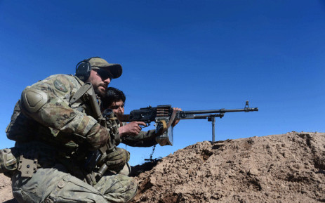 FILE: In this photograph taken on 9 February 2017, an Italian soldier from NATO's Resolute Support Mission trains an Afghan National Army (ANA) soldier at a Military Training centre on the outskirts of Herat. Picture: AFP